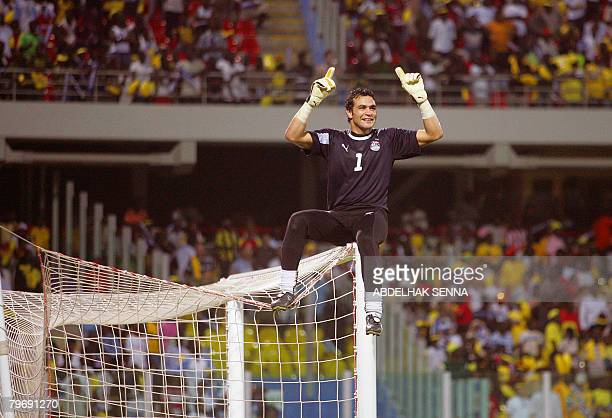 Egypt's Essam alHadary celebrates their victory against Cameroon on February 10 2008 in Accra after their final 2008 African Cup of Nations match...