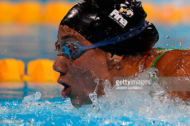 Egypt's Farida Osman competes in the heats of the women's 100metre butterfly swimming event in the FINA World Championships at Palau Sant Jordi in...