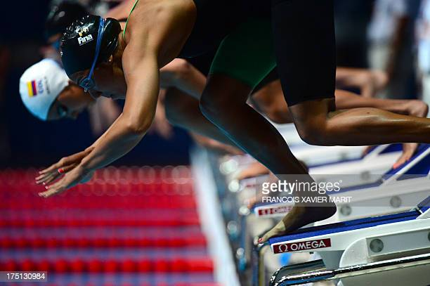 Egypt's Farida Osman competes in the heats of the women's 100metre freestyle swimming event in the FINA World Championships at Palau Sant Jordi in...