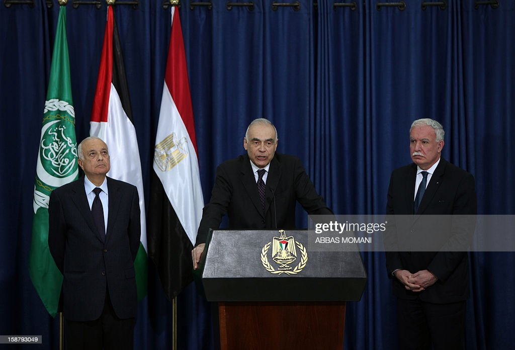 Egypt's Foreign Minister Mohamed Kamal Amr (C) speaks as Arab League Secretary General Nabil al-Arabi (L) and Palestinian Foreign Minister Riyad al-Malki (R) listen on during a press conference following their arrival in the West Bank city of Ramallah for a meeting with Palestinian president Mahmud Abbas on December 29, 2012. AFP PHOTO/ABBAS MOMANI