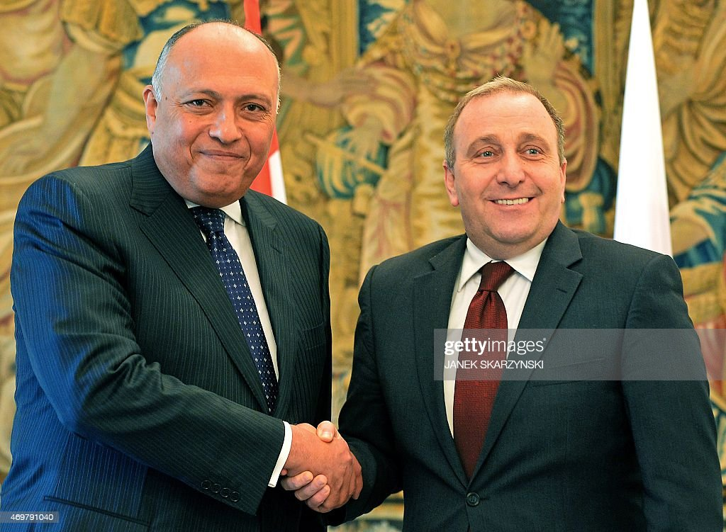 Egypt's Foreign Minister Sameh Hassan Shoukry and Polish Foreign Minister Grzegorz Schetyna shake hands during a meeting in Warsaw on April 15 2015...