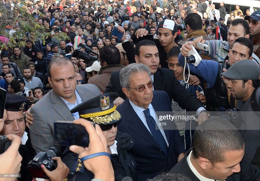 Egypt's former Foreign Minister Amr Mussa attends the funeral of veteran Arab film star Faten Hamama on January 18, 2015 on the outskirts of Cairo. Hamama, an Egyptian film icon and Omar Sharif's former wife, died on January 17, 2015 at the age of 83, their son Tarek Sharif told AFP. Hamama, who was less than 10 when she made her screen debut, appeared in almost 100 films and worked with masters of Egypt's massive film industry, including Youssef Chahine.