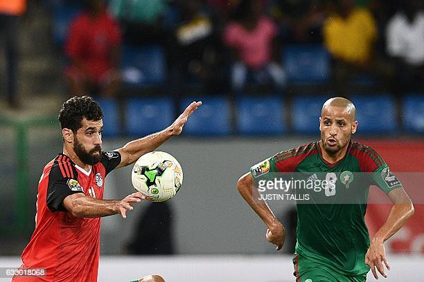 Egypt's forward Abdallah Said challenges Morocco's midfielder Karim El Ahmadi during the 2017 Africa Cup of Nations quarterfinal football match...