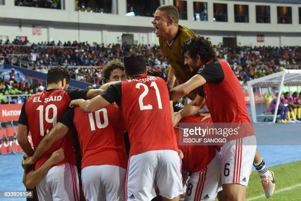 Egypt's forward Abdallah Said Egypt's forward Mohamed Salah and Egypt's midfielder Mahmoud Hassan celebrate following the team's first goal during...