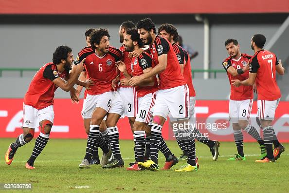 TOPSHOT Egypt's forward Mohamed Salah celebrates with teammates after scoring a goal during the 2017 Africa Cup of Nations group D football match...