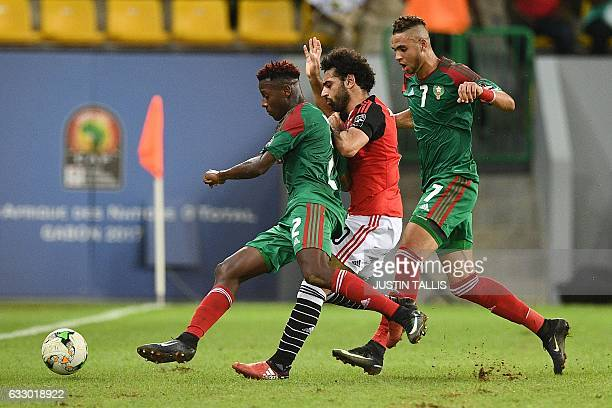 Egypt's forward Mohamed Salah challenges Morocco's defender Hamza Mendyl and Morocco's forward Youssef EnNesyri during the 2017 Africa Cup of Nations...