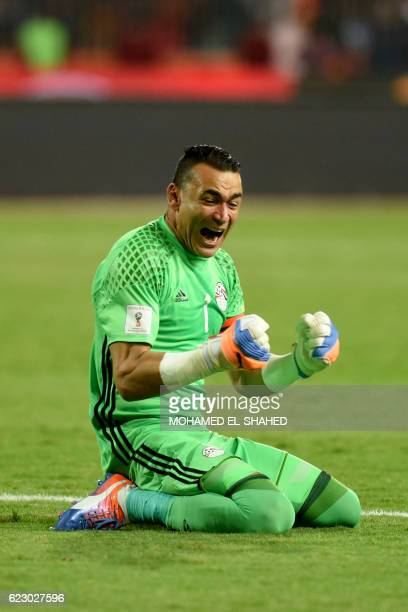 Egypt's goalkeaper Essam elHadary celebrates after Egypt scored a goal during the 2018 World Cup qualifying Group E football match between Egypt and...