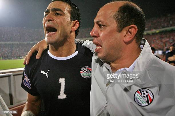 Egypt's goalkeeper Essam alHadary and goalkeeper coach Ahmed Suleiman react after beating Algeria in their 2010 World Cup African zone group C...