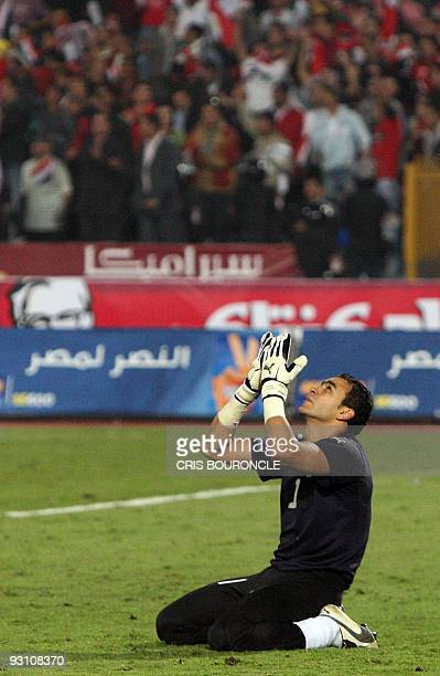 Egypt's goalkeeper Essam alHadary prays after beating Algeria in their 2010 World Cup African zone group C qualifying football match in Cairo on...