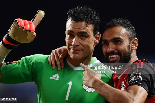 TOPSHOT Egypt's goalkeeper Essam El Hadary and Egypt's midfielder Ahmed Elmohamady celebrate at the end of the penalty shootout of the 2017 Africa...