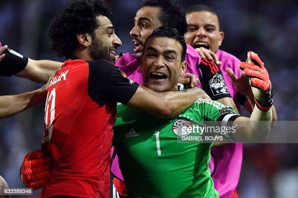 TOPSHOT Egypt's goalkeeper Essam El Hadary celebrates with teammates at the end of the penalty shootout of the 2017 Africa Cup of Nations semifinal...