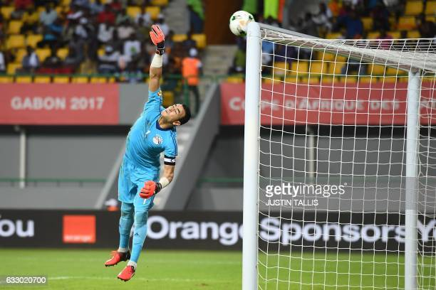 Egypt's goalkeeper Essam ElHadary jumps to block a shot on goal as the ball hits the crossbar during the 2017 Africa Cup of Nations quarterfinal...