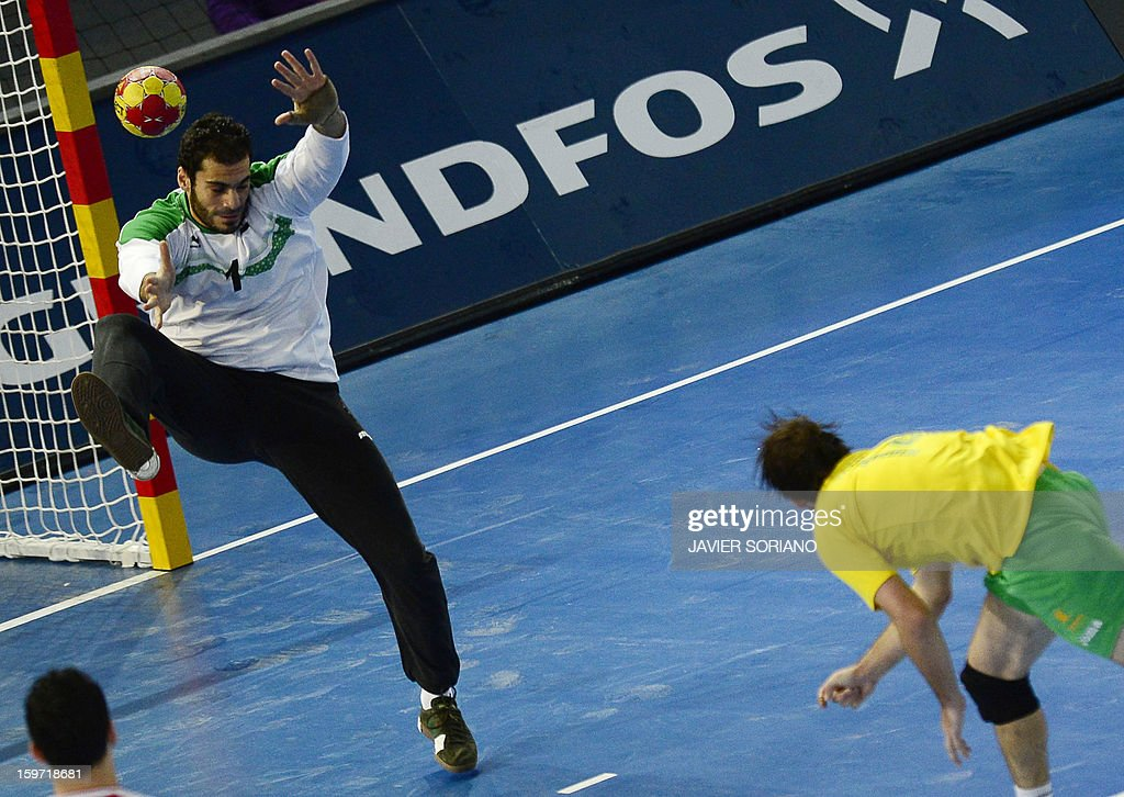 Egypt's goalkeeper Karim Mostafa (L) tries to stop a shot by Australia's left wing Mitchell Hedges during the 23rd Men's Handball World Championships preliminary round Group D match Egypt vs Australia at the Caja Magica in Madrid on January 19, 2013.
