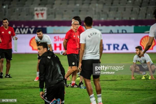 Egypt's head coach Hector Cuper attends a training session with his players at Borg alArab Stadium near Alexandria on September 4 on the eve of the...