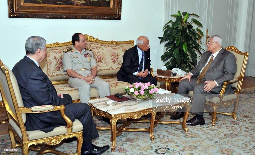 Egypt's Interior Minister Mohammed Ibrahim (L), Egypt's Defense Minister Abdel Fattah el-Sisi (2nd L) and Egyptian interim Prime Minister Hazem al-Beblawi (2nd R) meet with Interim President of Egypt Adly Mansour (R) in Cairo, Egypt.