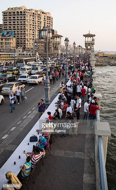 Egypts Mediterranean city of Alexandria seeks to enter the Guinness Book of World Records through preparing the longest Iftar table extending for...