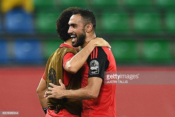 Egypt's midfielder Ahmed Elmohamady celebrates with teammate Ibrahim Salah at the end of the 2017 Africa Cup of Nations group D football match...