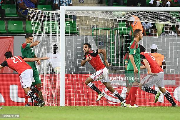 Egypt's midfielder Mahmoud AbdelMoneim celebrates with teammates after scoring a goal during the 2017 Africa Cup of Nations quarterfinal football...
