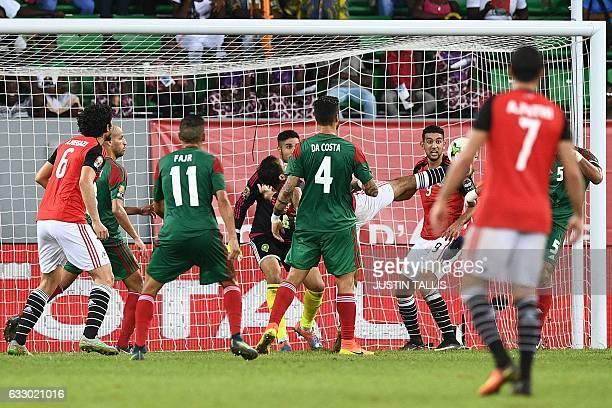 Egypt's midfielder Mahmoud AbdelMoneim kicks the ball to score his team's winning goal during the 2017 Africa Cup of Nations quarterfinal football...