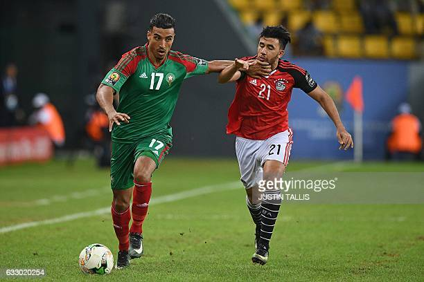 Egypt's midfielder Mahmoud Hassan challenges Morocco's midfielder Nabil Dirar during the 2017 Africa Cup of Nations quarterfinal football match...
