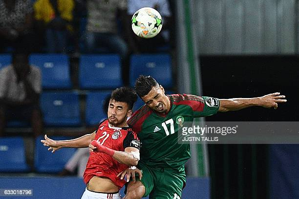 Egypt's midfielder Mahmoud Hassan heads the ball with Morocco's midfielder Nabil Dirar during the 2017 Africa Cup of Nations quarterfinal football...