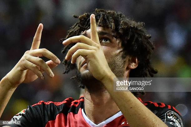 Egypt's midfielder Mohamed Elneny celebrates scoring the first goal of the match during the 2017 Africa Cup of Nations final football match between...
