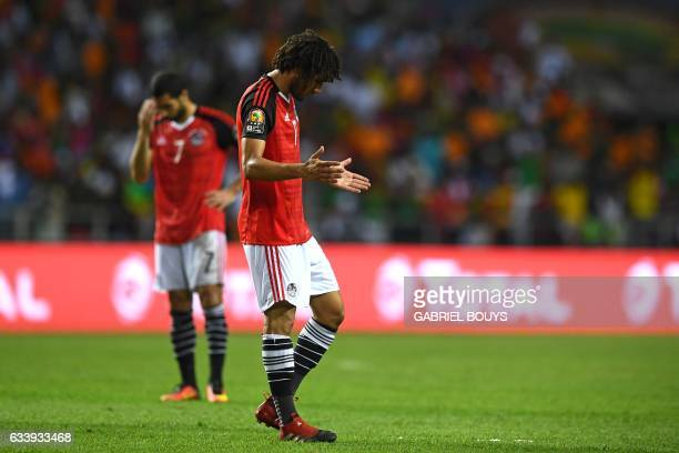 Egypt's midfielder Mohamed Elneny reacts after his team lost to Cameroon in the 2017 Africa Cup of Nations final football match between Egypt and...