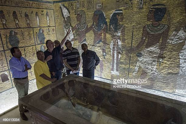 Egypt's Minister of Antiquities Mamdouh alDamati listens to British Egyptologist Nicholas Reeves near the sarcophagus of King Tutankhamun in his...
