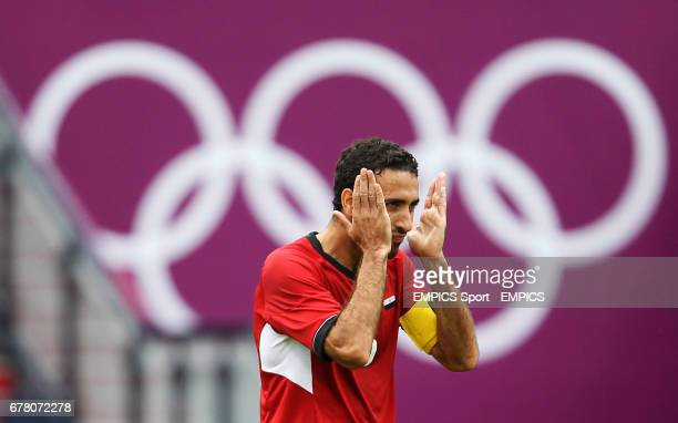 Egypt's Mohamed Aboutrika celebrates his side winning against Belarus in the Group C Men's Football match at Hampden Park Glasgow