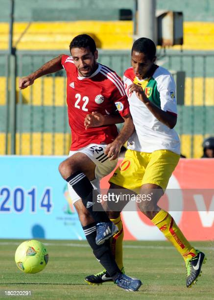 Egypt's Mohamed Aboutrika vies with Guinea's Habib Balde during their FIFA 2014 World Cup qualifying football match at AlGouna stadium on September...