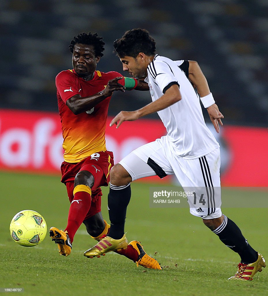 Egypt's Mohamed al-Nenny (R) fights for the ball against Ghana's Anthony Annan during their friendly football match in Abu Dhabi on January 10, 2013.