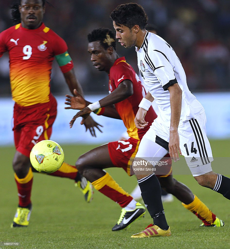 Egypt's Mohamed Ibrahim (R) fights for the ball against Ghana's Derek Boateng (L) and John Boye (C) during their friendly football match in Abu Dhabi on January 10, 2013.