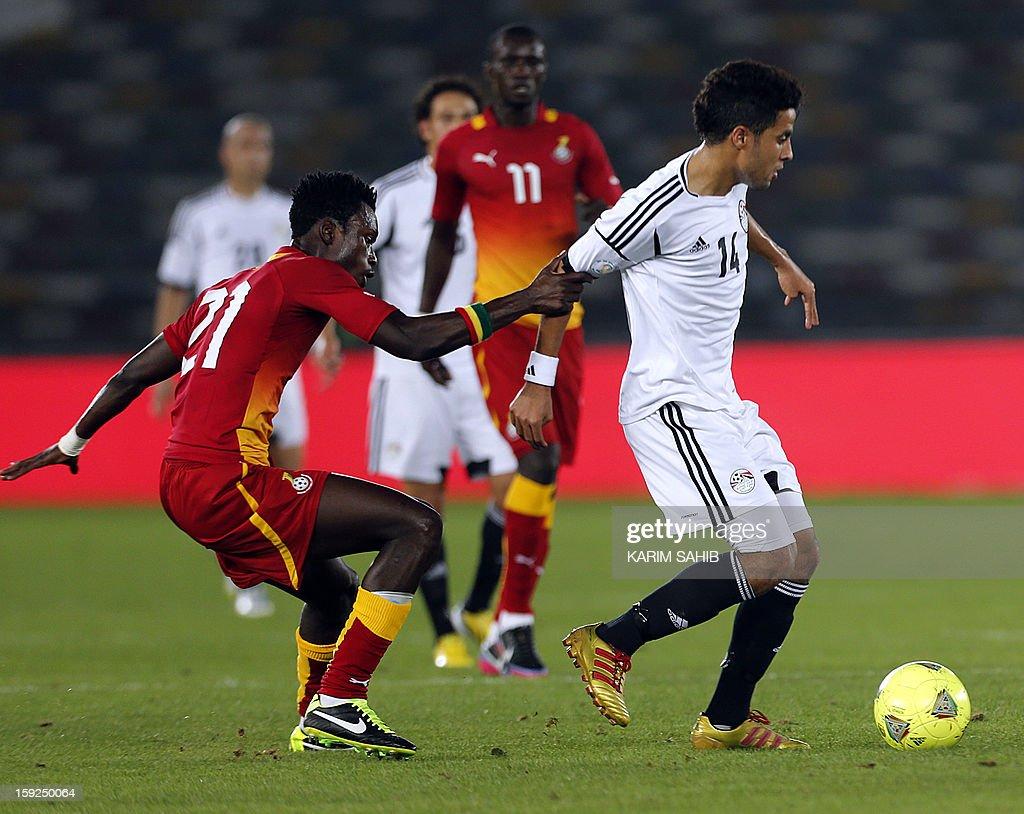 Egypt's Mohamed Ibrahim (R) fights for the ball against Ghana's John Boye (L) during their friendly football match in Abu Dhabi on January 10, 2013.