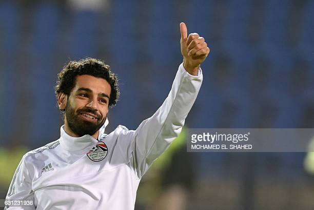 Egypt's Mohamed Salah gestures as he takes part in a training session prior to the international friendly football match between Egypt and Tunisia at...