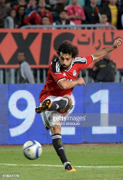 Egypt's Mohamed Salah kicks the ball during African Cup of Nations group G qualification football match between Egypt and Nigeria at the Borg elArab...