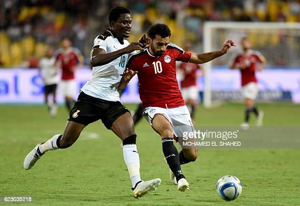 Egypt's Mohamed Salah vies for the ball against Ghana's Daniel Amartey during the 2018 World Cup qualifying Group E football match between Egypt and...