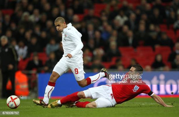 Egypt's Mohamed Zidan and England's Frank Lampard battle for the ball