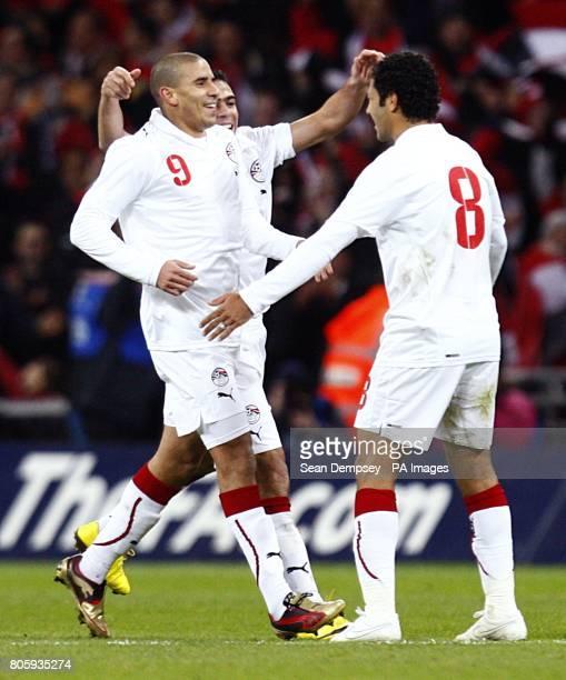 Egypt's Mohamed Zidan celebrates scoring the opening goal with team mate Hosni Abd Rabou