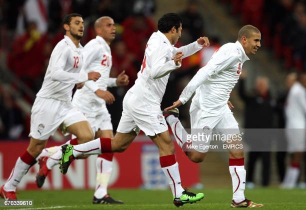 Egypt's Mohamed Zidan celebrates with his team mates after scoring his side's first goal of the game