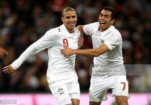 Egypt's Mohamed Zidan celebrates with team mate Ahmed Fathi after scoring his side's first goal of the game