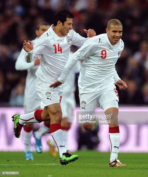 Egypt's Mohamed Zidan runs to celebrate scoring the opening goal