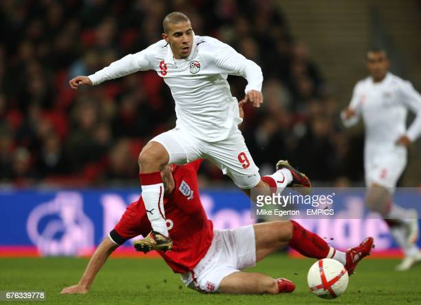 Egypt's Mohamed Zidan skips over the challenge from England's Frank Lampard