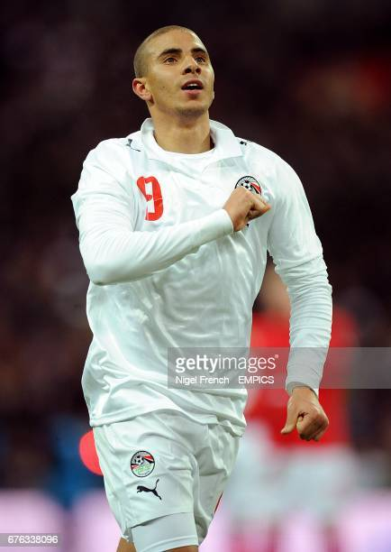 Egypt's Mohamed Zidan taps his badge after scoring the opening goal