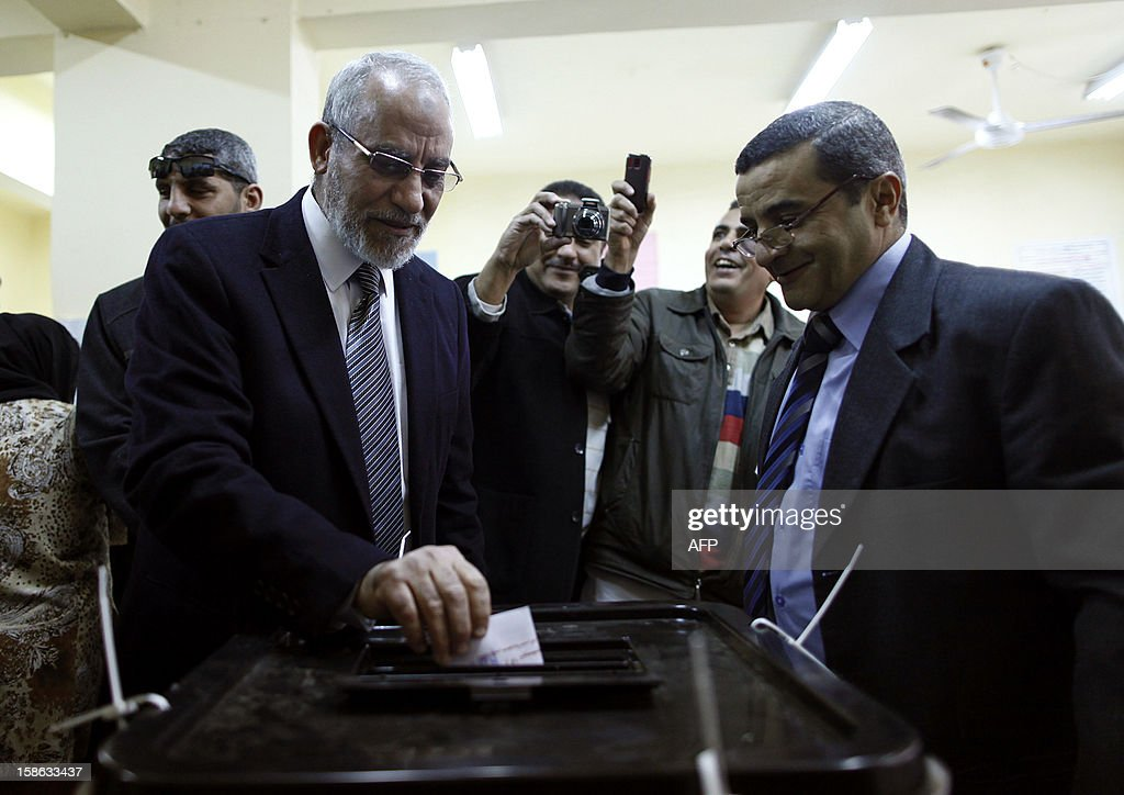 Egypt's Muslim Brotherhood leader Mohammed Badie (L) casts his vote at a polling station during the second round of a referendum on a new draft constitution in Beni Sueif, south of Cairo, on December 22, 2012. Egyptians are voting in the final round of a referendum on a new constitution championed by President Mohamed Morsi and his Islamist allies against fierce protests from the secular-leaning opposition.