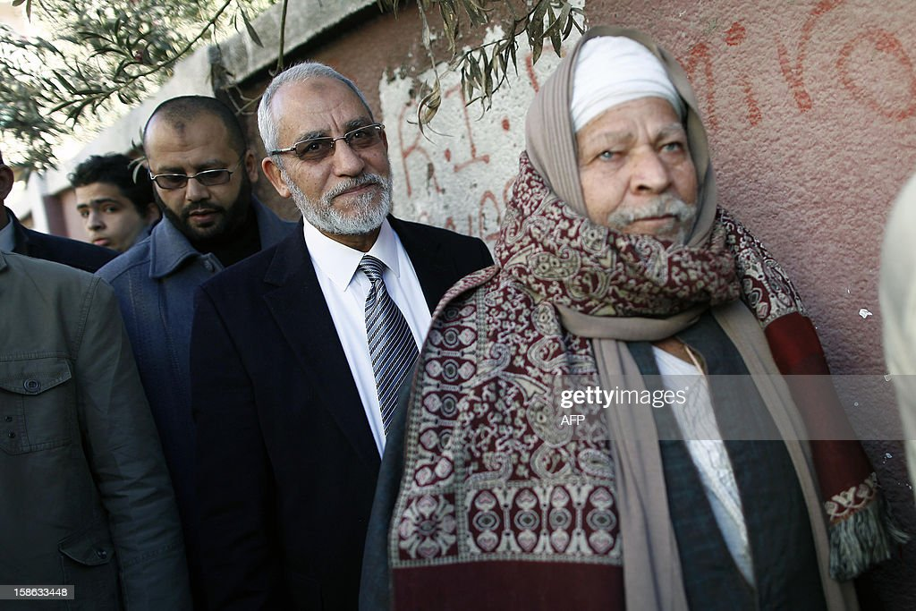 Egypt's Muslim Brotherhood leader Mohammed Badie (C) queues with other voters at a polling station during the second round of a referendum on a new draft constitution in Beni Sueif, south of Cairo, on December 22, 2012. Egyptians are voting in the final round of a referendum on a new constitution championed by President Mohamed Morsi and his Islamist allies against fierce protests from the secular-leaning opposition.