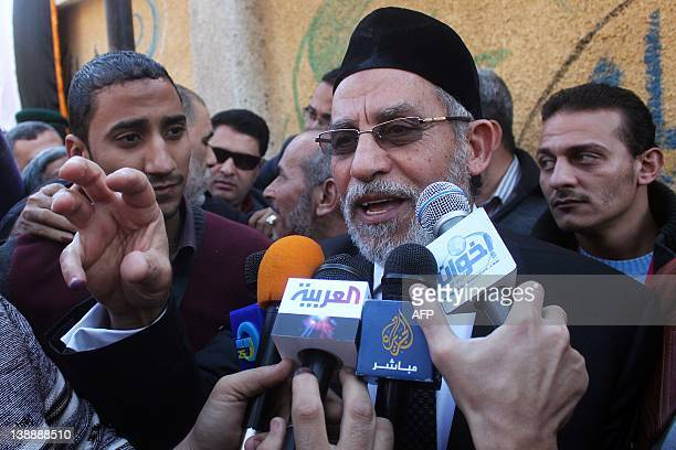 Egypt's Muslim Brotherhood leader Mohammed Badie speaks to the media outside a polling station in Beni Suef on December 15 during the second round of...