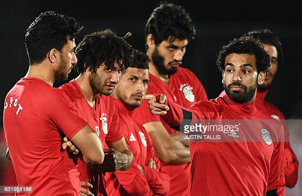Egypt's national football team listen as Egypt's forward Mohamed Salah gestures during a training session in PortGentil on January 18 during the 2017...