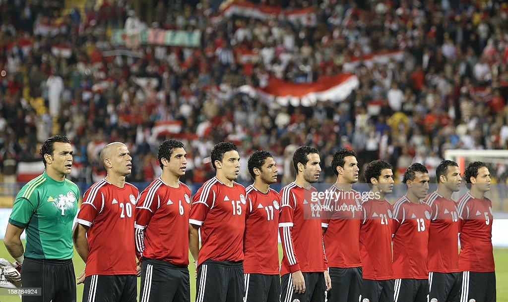 Egypt's national football team sings its national anthem before a friendly football match against Qatar in the Qatari capital Doha on December 28, 2012. Egypt won 2-0. AFP PHOTO / AL-WATAN DOHA / KARIM JAAFAR == QATAR OUT ==
