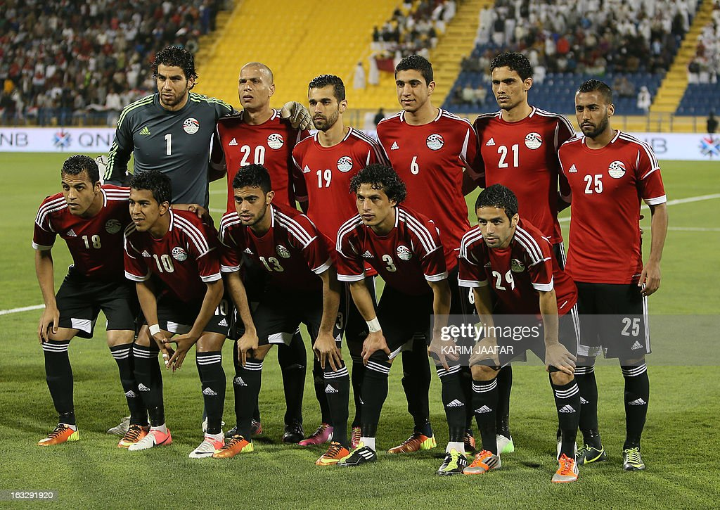 Egypt's national team's players pose before the friendly football Qatar versus Egypt in the Qatari capital Doha on March 7, 2013. The match comes in the frame of the both national teams preparation for Asian and African qualification rounds for FIFA 2014 World Cup Finals in Brazil. AFP PHOTO / AL-WATAN DOHA / KARIM JAAFAR == QATAR OUT ==
