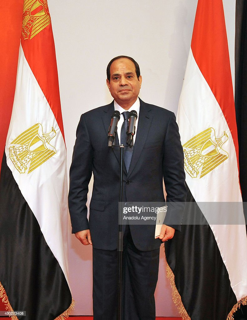 Egypt's new president Abdel Fattah el-Sisi takes the presidential oath in front of the general board members of Egyptian supreme court and Egypt's former interim president Adly Mansour (not seen) at the supreme court building in Cairo, Egypt on June 8, 2014.